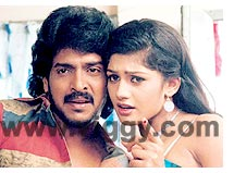Upendra and Radhika in Auto Shankar